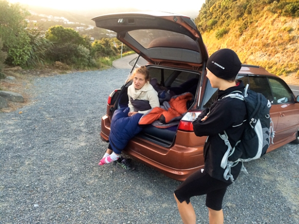 Ewa not enjoying the early morning shift being on support watch at top of Makara Hill - apparently sleeping in a car is not that fun whilst people are out running through the night